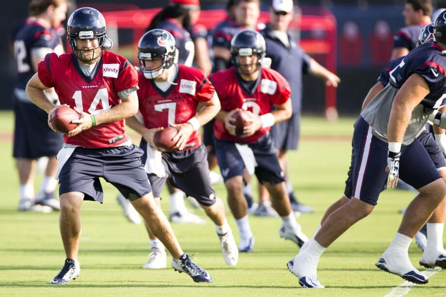 Quarterbacks Ryan Fitzpatrick (14), Case Keenum (7) and Tom Savage (3) run a drill. Photo: Brett Coomer, Houston Chronicle