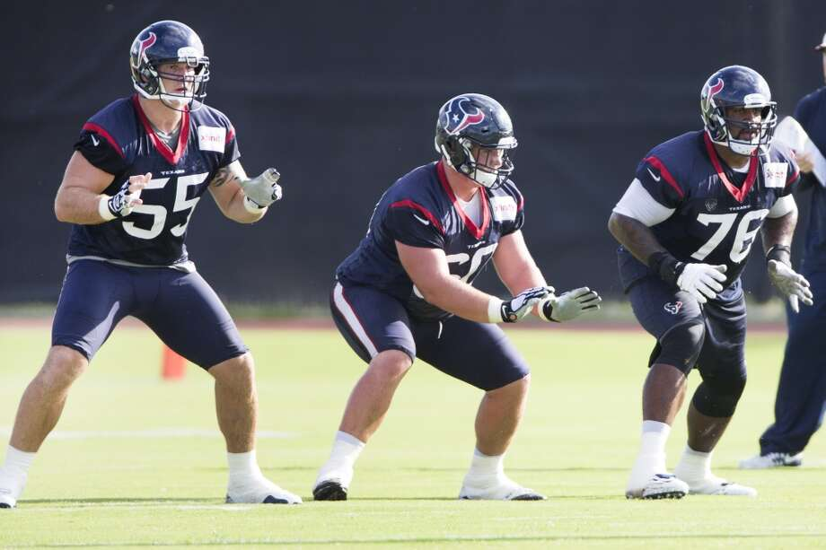 Texans center Chris Myers (55), guard Ben Jones (60) and tackle Duane Brown (76) drop back into a pass-block scheme. Photo: Brett Coomer, Houston Chronicle