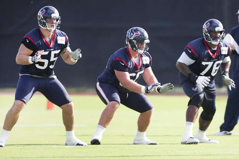 Texans center Chris Myers (55), guard Ben Jones (60) and tackle Duane Brown (76) drop back into a pa