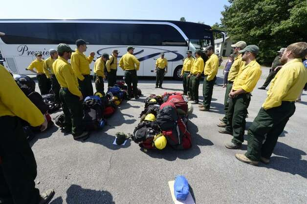 Forest rangers and other employees from the state Department of Environmental Conservation returned to the region Tuesday, Aug. 11, 2014, after two weeks helping the fight against wildfires in Washington state. They helped contain the Chiwaukum Creek Complex Wildfires. (Skip Dickstein / Times Union)