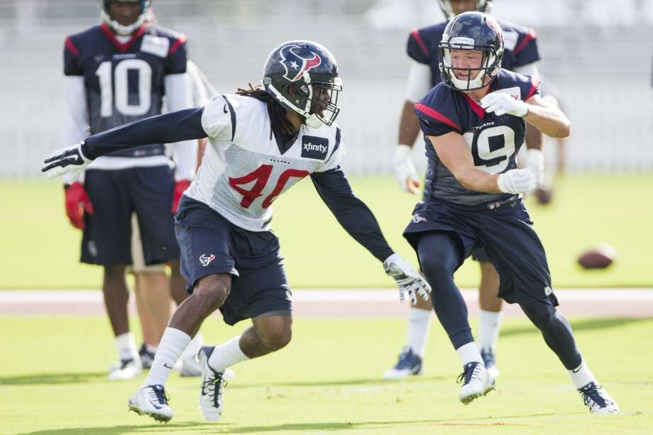 Defensive back Marcus Williams (40) and  wide receiver Travis Labhart (19) run a pass coverage drill. Photo: Brett Coomer, Houston Chron