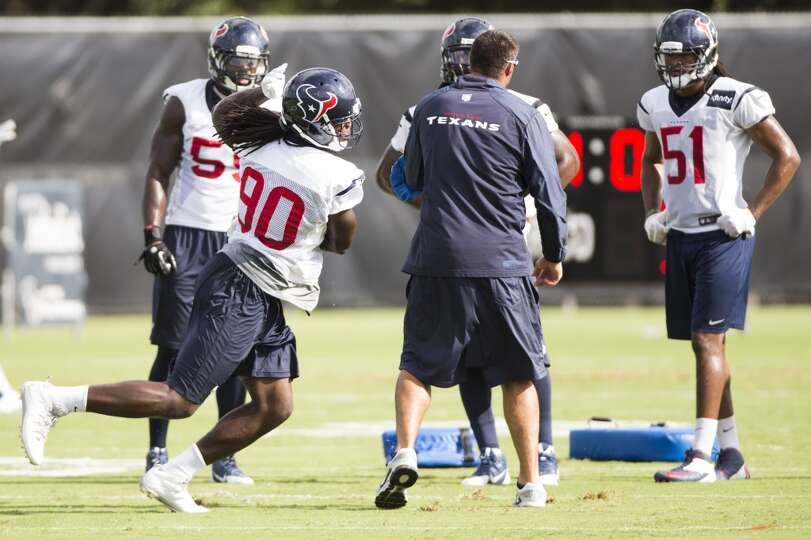 Linebacker Jadeveon Clowney (90) runs a drill.