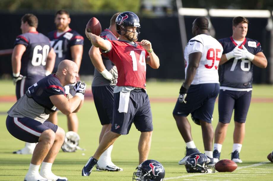 Day 12: August 11Quarterback Ryan Fitzpatrick (14) throws the football. Photo: Brett Coomer, Houston Chronicle