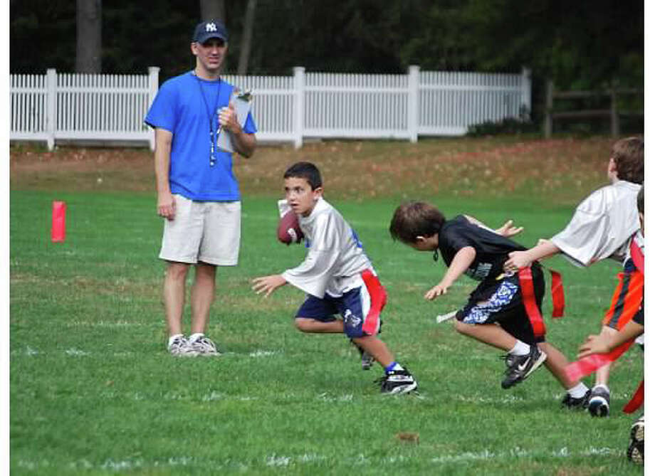 Second-grader Domenick Zawacki runs with the ball during a 2013 Darien Junior Football League (DJFL) flag football game. The DJFL will hold second and third grade flag football tryouts and team selection on Saturday, September 6, at Royle School. The third grade session will begin at 9:00. The second grade session is set to begin at 9:45. Players should wear gym clothes, bring water, and arrive 15 minutes early to sign in. All registered players will be placed on teams afterward. The season begins Saturday, September 20, and runs for seven weeks, with all games played on Saturday mornings at Royle Field. Start times vary from 8 a.m. to 1 p.m. First grade flag begins Saturday, September 13, at Royle School, from 4-5:30 p.m., and it runs for seven weeks. Please register online at DJFL.org. Unregistered players should sign up immediately at DJFL.org. Any questions should be directed towards Vicki Patton at 203-554-5373 or vpatton@optonline.net. Photo: Contributed / Darien News Contributed