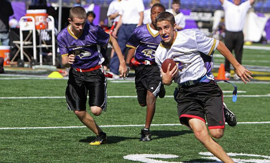 New Canaan's Matt Toth runs with the ball during a national flag football tournament at M&T Bank Stadium, home of the Baltimore Ravens, during the 2011 season. Photo: Contributed / New Canaan News Contributed