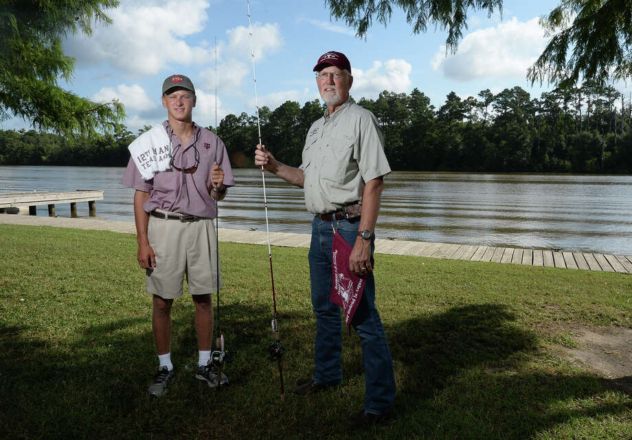 The Beaumont A&M Club will host its 17th annual fishing tournament at Pleasure Island on Saturday. Nick Prewitt and Tom Natho hold their fishing rods at Colliers Ferry Park on Friday.   Photo taken Friday, August 08, 2014 Guiseppe Barranco/@spotnewsshooter Photo: Guiseppe Barranco, Photo Editor