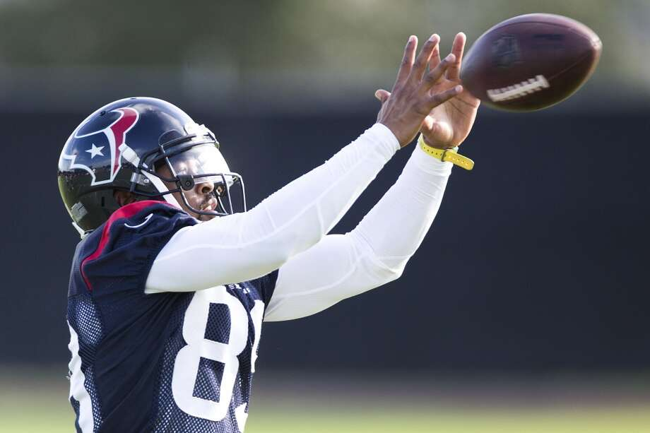 Wide receiver Mike Thomas reaches out to make a catch. Photo: Brett Coomer, Houston Chronicle