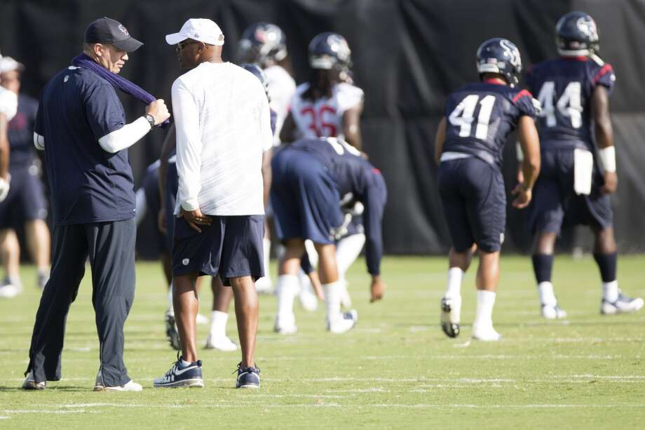 Head coach Bill O'Brien, left, talks to general manager Rick Smith. Photo: Brett Coomer, Houston Chronicle