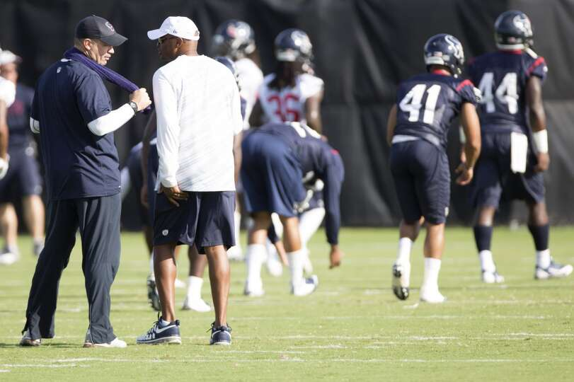 Head coach Bill O'Brien, left, talks to general manager Rick Smith.