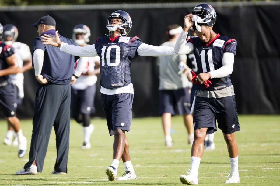 Wide receiver DeAndre Hopkins (10) spreads his arms wide as he walks upfield with wide receiver DeVier Posey (11). Photo: Brett Coomer, Houston Chronicle