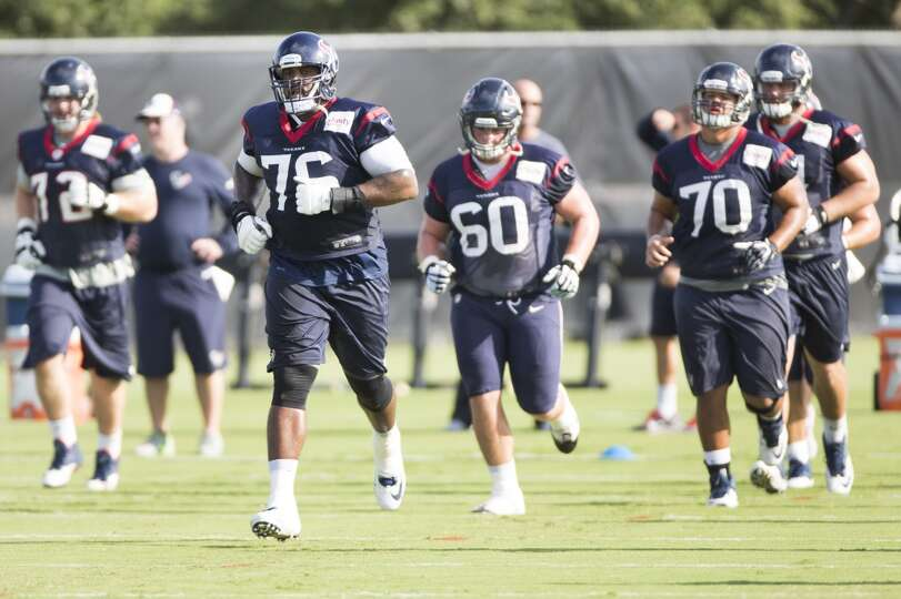 Tackle Duane Brown (76) jogs up field, following by guard Ben Jones (60) and guard Xavier Su'a-Filo
