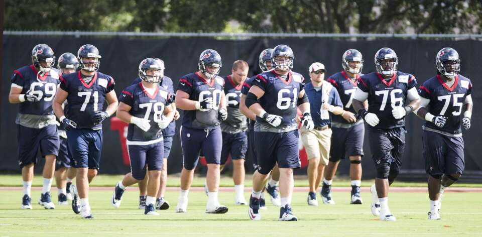 Offensive linemen run upfield.