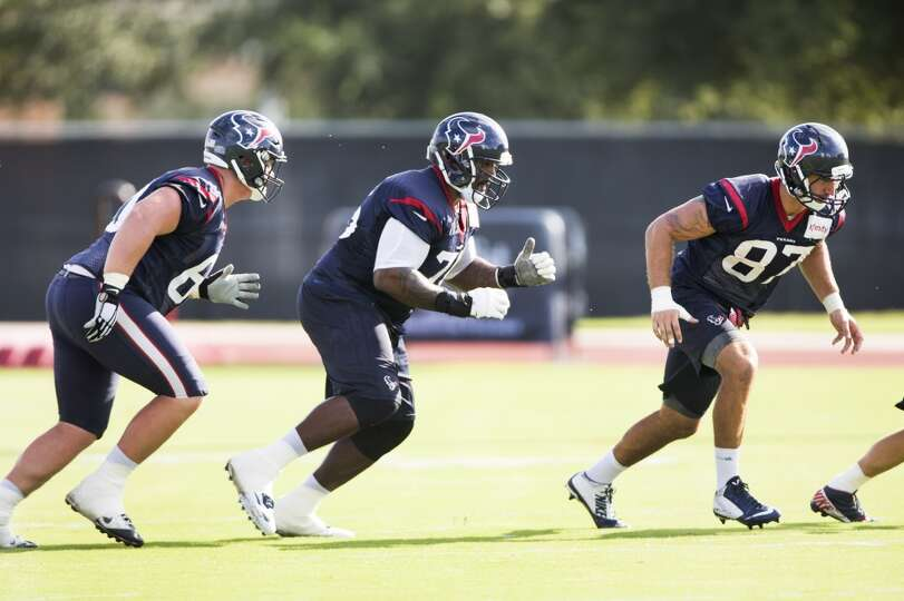 Texans guard Ben Jones (60), tackle Duane Brown (76) and tight end C.J. Fiedorowicz (87) run a play.