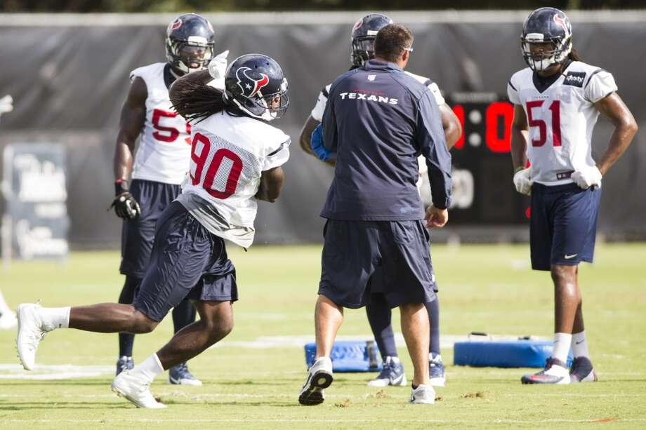 Linebacker Jadeveon Clowney (90) runs a drill. Photo: Brett Coomer, Houston Chronicle