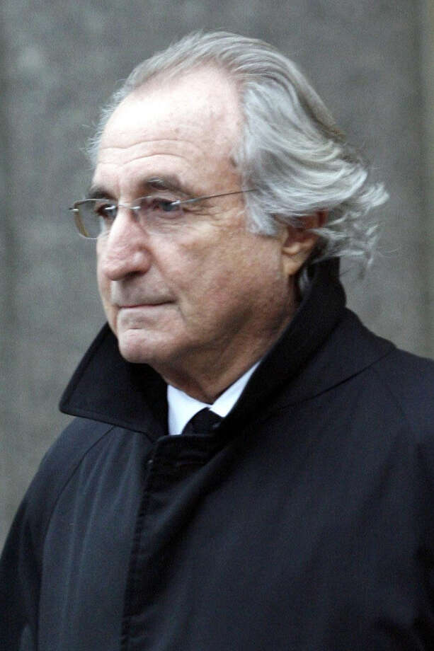 Bernard L. Madoff leaves Federal Court in New York in this file photo.  (AP Photo/Stuart Ramson, file) Photo: Stuart Ramson, Associated Press / Associated Press contributed