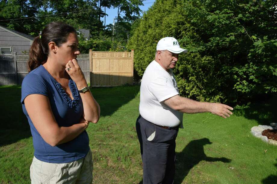 Michael Papa, right, owner of Artscape Organic Care LLC in Stamford, explains to Gaby Beecher, of New Canaan, about the ecosystem of her lawn. Jarret Liotta/For the New Canaan News Photo: Contributed Photo, Contributed / New Canaan News Contributed