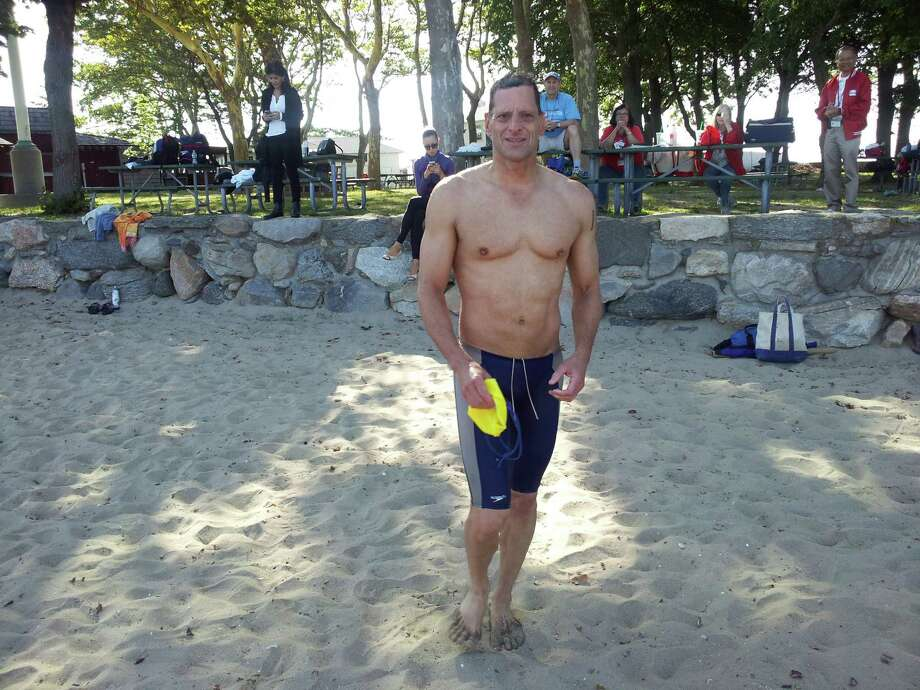Craig Nadel was the overall winner of the 2014 Island Beach Two-Mile Swim on Saturday. Photo: Contributed Photo / Greenwich Time Contributed