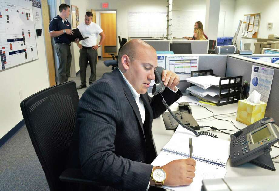 "David Gerth works the the phones in ""the pit"" in the Aerotek offices Friday July 11, 2014, in Colonie, NY.  (John Carl D'Annibale / Times Union) Photo: John Carl D'Annibale / 00027741A"
