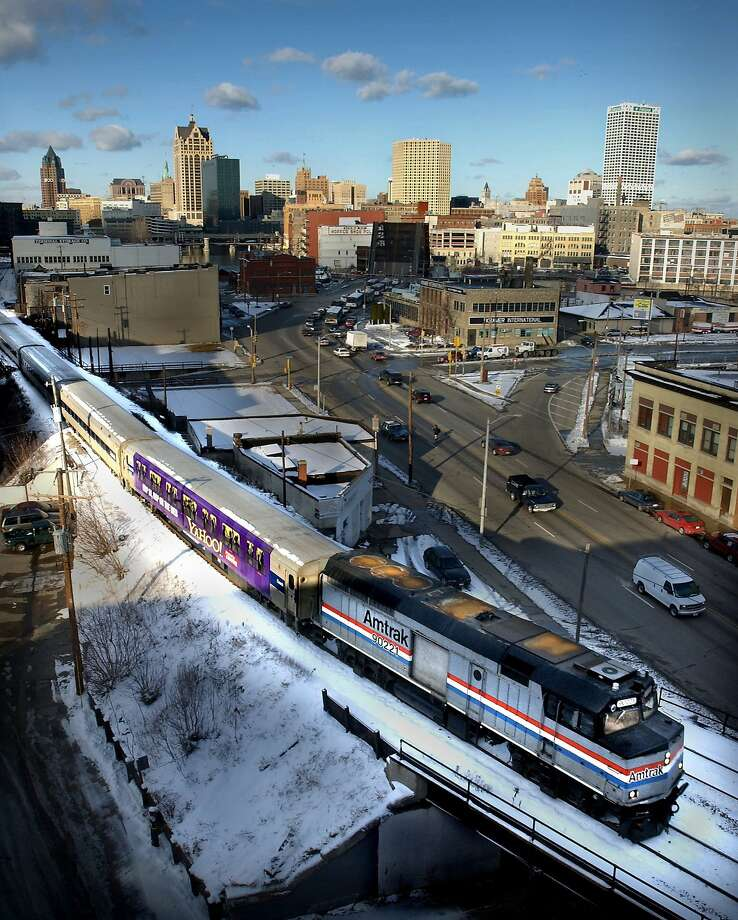 An Amtrak train, part of Hiawatha Service, leaves Milwaukee bound for Chicago on Friday, Feb. 1, 2002. Hiawatha Service between the cities would be one of the remaining passenger train services left in the country if Amtrak discontinues long-distance overnight passenger service in October, as it threatened to do Friday. (AP photo/The Milwaukee Journal Sentinel, Dale Guldan) ALSO RAN 2/10/02 Photo: Dale Guldan, AP