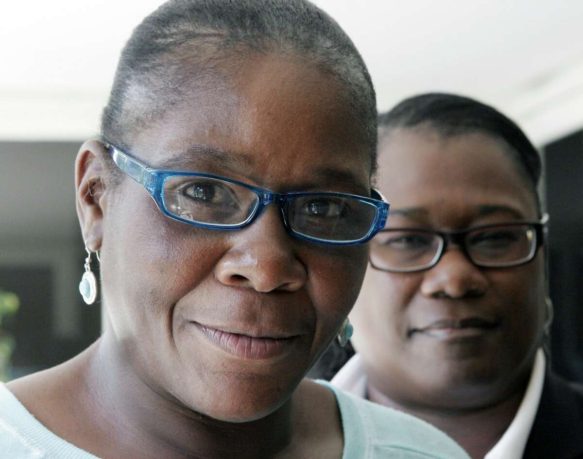 Marlene Pinnock, left, poses with her attorney, Caree Harper during an interview Sunday Aug. 10, 2014 in Los Angeles. Pinnock, a homeless woman was beaten by a CHP officer in July 2014. Sunday was Pinnock's first publicized interview since the incident, that was videotaped. (AP Photo/John Hopper)