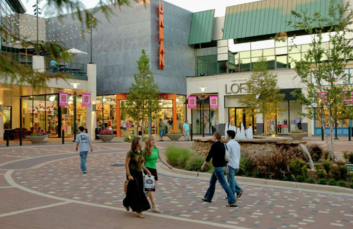 Shoppers enjoy upscale stores or dining at one of the many restaurants at The Woodlands Mall and Market Street in The Woodlands Town Center.
