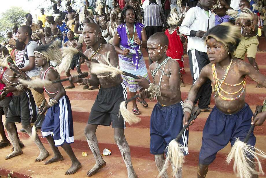 Boys from the Bukusu ethnic group participate in a circumcision ceremony. The practice is not adopted by all tribes. Photo: Str, Associated Press
