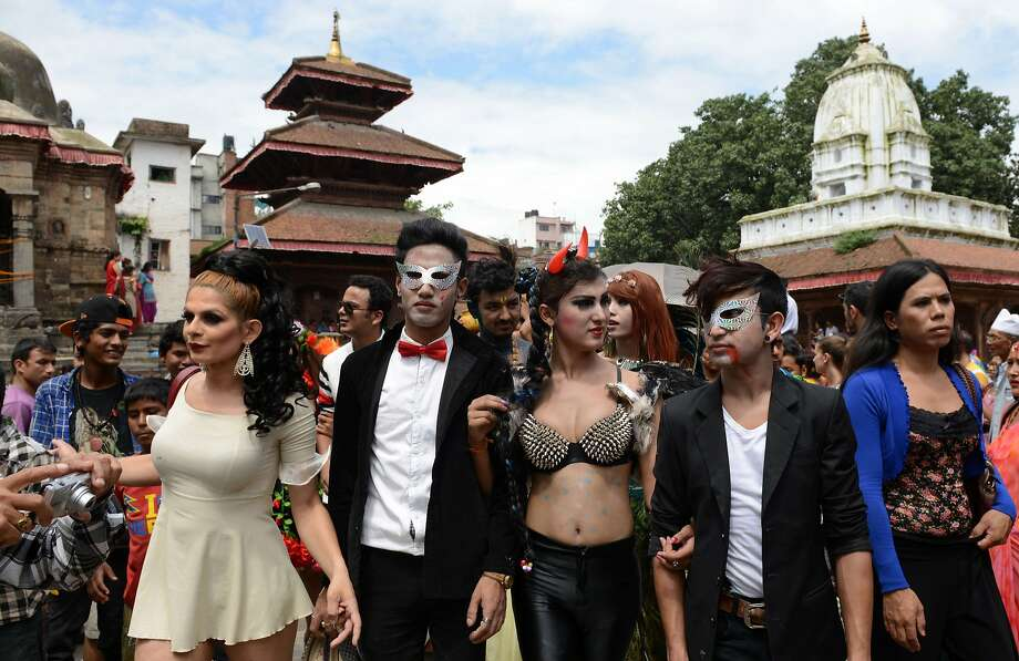 Hundreds of lesbians, gays, bisexuals and transvestites from across Nepal join the parade in Kathmandu during the annual Hindu festival to remember the dead. Photo: Prakash Mathema, AFP/Getty Images