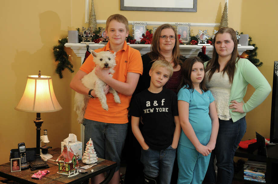 Sabrina Carr -  with her children Frankie, 13, from left, Blake, 9,  Samantha, 10, and Victoria, 15 - has accumulated about $7,500 in out-of-network costs, despite paying almost $1,000 per month for insurance. Photo: Jerry Baker, Freelance