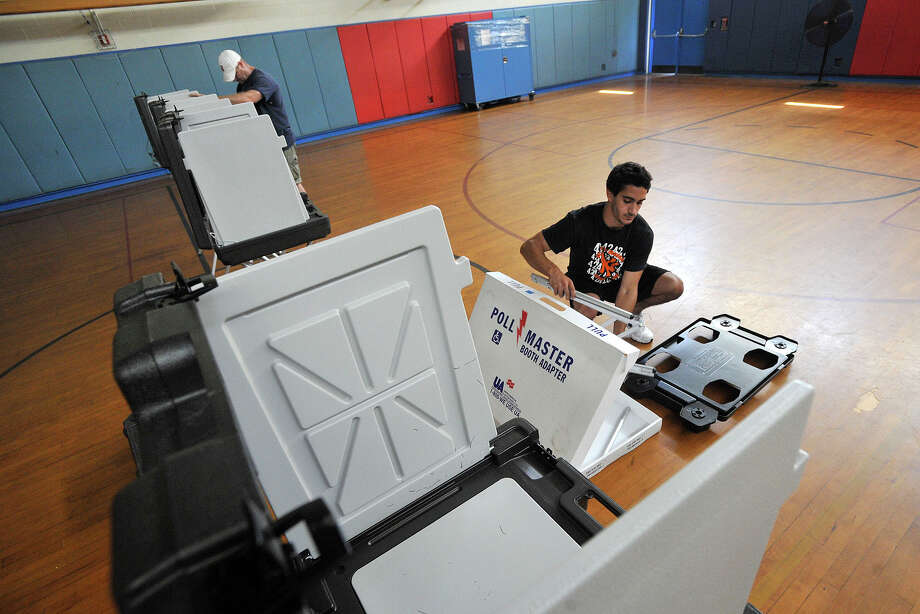 Poll workers Jake Bivona, right, and Barry Hunt assemble voting booths in the Northeast Elementary School gym in North Stamford, Conn., on Monday, Aug. 11, 2014, in preparation for Tuesday's GOP primary. Photo: Jason Rearick / Stamford Advocate