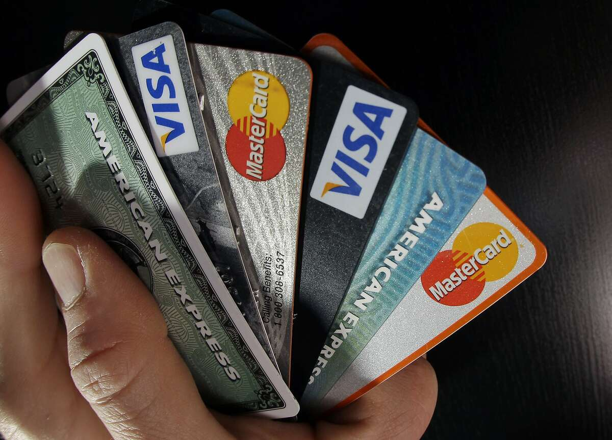 In this March 5, 2012 photo, consumer credit cards are posed in North Andover, Mass. Consumer borrowing rose by $17.8 billion in January, the Federal Reserve said Wednesday, March 7, 2012. That followed similar gains in December and November. (AP Photo/Elise Amendola)