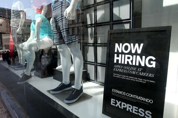 SAN FRANCISCO, CA - JUNE 06:  A now hiring sign is posted in the window of a clothing store on June 6, 2014 in San Francisco, California.  According the Labor Department, the hiring pace remained strong for the fourth straight month with employers adding 217,000 jobs in May. The national unemployment rate stands at 6.3 percent.  (Photo by Justin Sullivan/Getty Images)