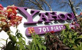 FILE - In this Jan. 4, 2012 file photo, the company logo is displayed at Yahoo headquarters in Sunnyvale, Calif. One of Britain's youngest Internet entrepreneurs has hit the jackpot after selling his top-selling mobile application Summly to search giant Yahoo the company announced Monday March 25, 2012.
