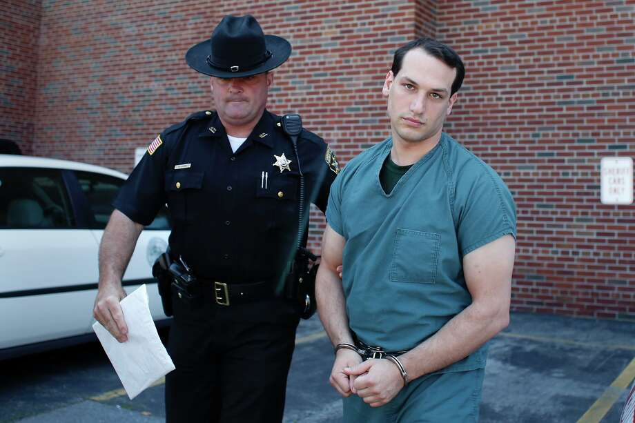 Ryan Place, a man who kidnapped and tortured a woman, is escorted by the Saratoga County Sheriffs department into the Saratoga County Courthouse for sentencing Monday, Aug. 11, 2014, in Ballston Spa, N.Y. (Tom Brenner/ Special to the Times Union) Photo: Tom Brenner / ©Tom Brenner/ Albany Times Union