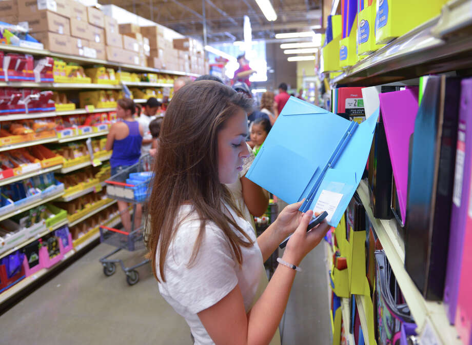 Katie Wolfe, who is going to be a freshman at Johnson High School, looks over tax-free school supplies while shopping with her mother in the HEB store at 1604 and Evans Rd. Saturday. Photo: Robin Jerstad, For The Express-News / San Antonio Express-News