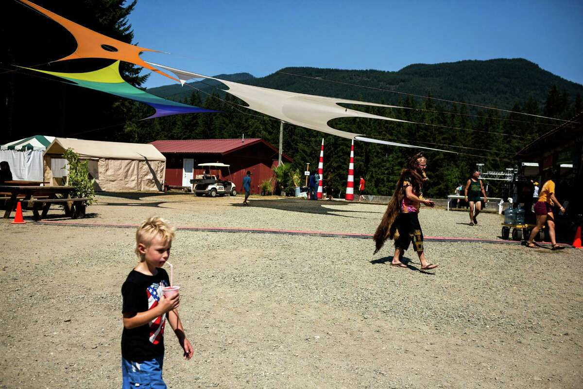 Attendees of all sizes and outfits move around the campsites on the third and final day of the 14th annual Summer Meltdown, the