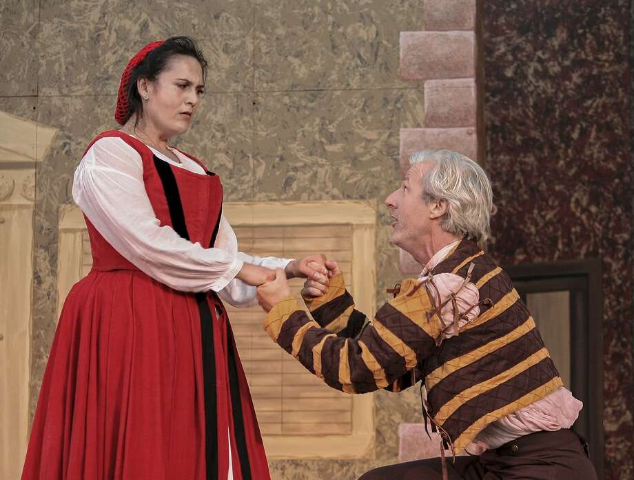 "Katherina (Carla Pantoja, left) doesn't know what to make of the unexpected wooing tactics of Petruccio (Tim Kniffin) in ""The Taming of the Shrew."" Photo: John Western"
