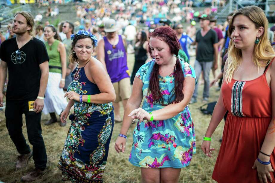 "Attendees dance to the sounds of The Acorn Project on the third and final day of the 14th annual Summer Meltdown, the ""Biggest Little Festival in The Northwest,"" on Sunday, August 10, 2014, at the Whitehorse Mountain Amphitheater in Darrington, Wash. Photo: JORDAN STEAD, SEATTLEPI.COM / SEATTLEPI.COM"