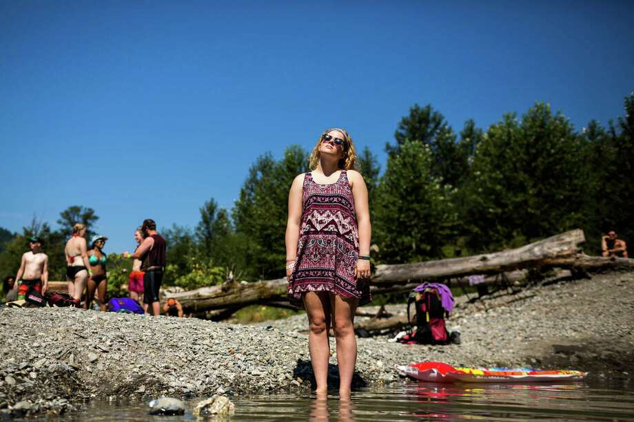 As means to get the third and final day of the 14th annual Summer Meltdown started, dozens of attendees took to the sands of the Stillaguamish River to cool off and prepare for the evening's upcoming musical acts Sunday, August 10, 2014, at the Whitehorse Mountain Amphitheater in Darrington, Wash. Photo: JORDAN STEAD, SEATTLEPI.COM / SEATTLEPI.COM