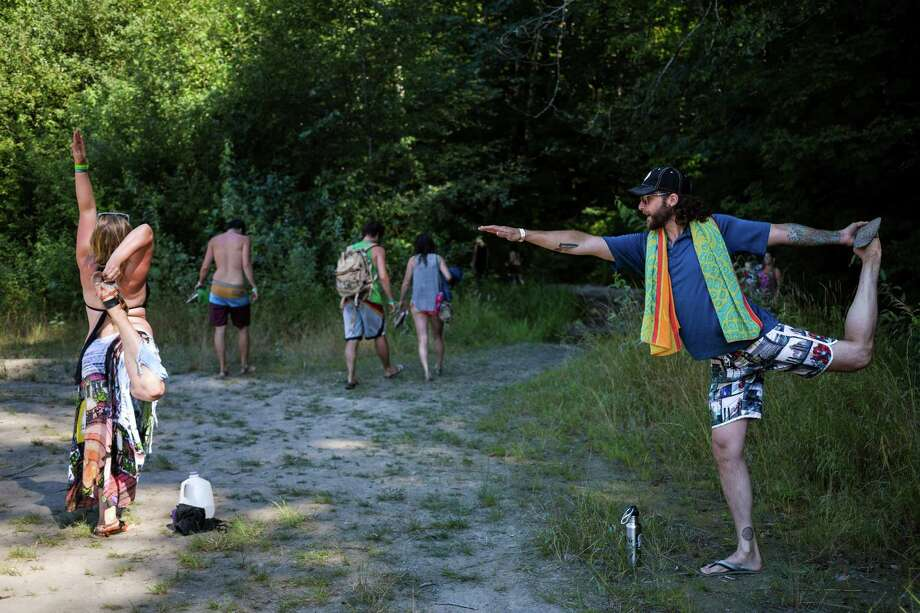 """Event attendees start an impromptu yoga session on the third and final day of the 14th annual Summer Meltdown, the """"Biggest Little Festival in The Northwest,"""" on Sunday, August 10, 2014, at the Whitehorse Mountain Amphitheater in Darrington, Wash. Photo: JORDAN STEAD, SEATTLEPI.COM / SEATTLEPI.COM"""