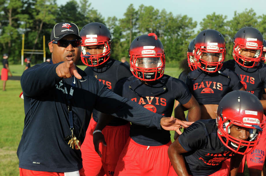 Aldine Davis Head Football Coach James Showers, left, pumps up his team on the first day of practice for the school which is in its first year of varsity football this season. Photo: Jerry Baker, For The Chronicle