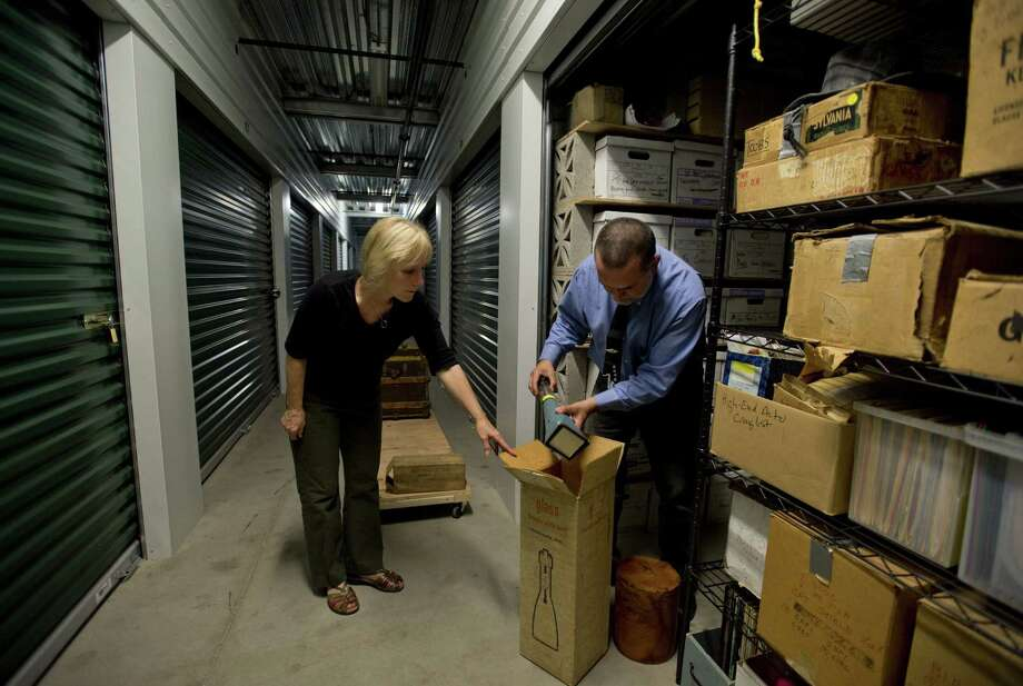 Professional organizer Claudia Smith helps Alan Miller pare down his parents' belongings in Davis, Calif. A reader says we should not trouble ourselves by tossing out the personal archives of our lives. Photo: Jose Luis Villegas / Sacramento Bee / Sacramento Bee