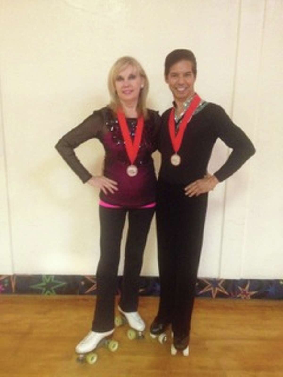 Mykal Pedraza (right) became the oldest person to win a gold medal in a U.S. roller skating free style event in August 2014 at age 56.