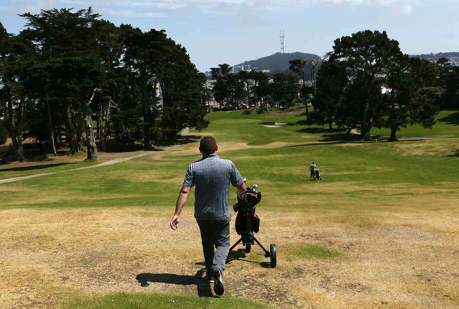 Tommy Noonan of County Clare, Ireland, walks up a fairway at Lincoln Park Golf Course in S.F. Photo: Scott Strazzante, The Chronicle