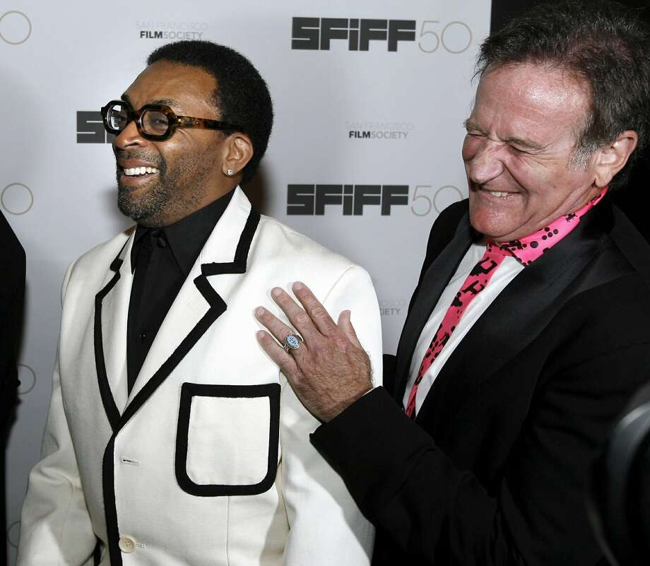 Awards recipients, director Spike Lee (L) and actor Robin Williams, laugh before the 50th San Francisco International Film Festival's Film Society Awards in San Francisco, California, May 3, 2007. Photo: Dino Vournas, REUTERS