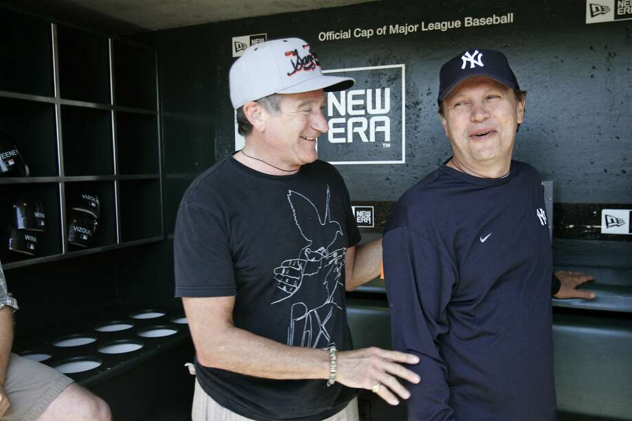 Comedians Robin Williams and Billy Crystal were in the Giants dugout before a game in 2007. Photo: Deanne Fitzmaurice, SFC