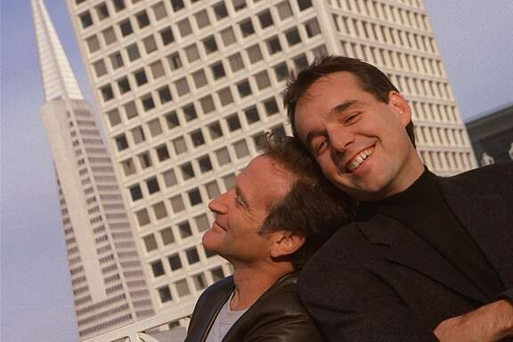 BICENTENNIEL12B-C-05DEC99-PK-RW-Robin Williams (left) and director Chris Columbus pose atop the Ritz-Carlton Hotel in San Francisco. BY ROBIN WEINER/THE CHRONICLE