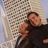 Robin Williams (left) and director Chris Columbus pose atop the Ritz-Carlton Hotel in San Francisco in 1999.