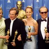 "Holding their Oscar awards for acting, (left to right) Kim Basinger, Robin Williams, Helen Hunt and Jack Nicholson celebrate their success following the 70th Annual Academy Awards, March 23 in Los Angeles. Basinger won best supporting actress for her role in ""L.A. Confidential,"" Williams won best supporting actor for ""Good Will Hunting,"" Hunt won best actress for her role in ""As Good As It Gets,"" and Nicholson won best actor for his role in ""As Good As It Gets."""