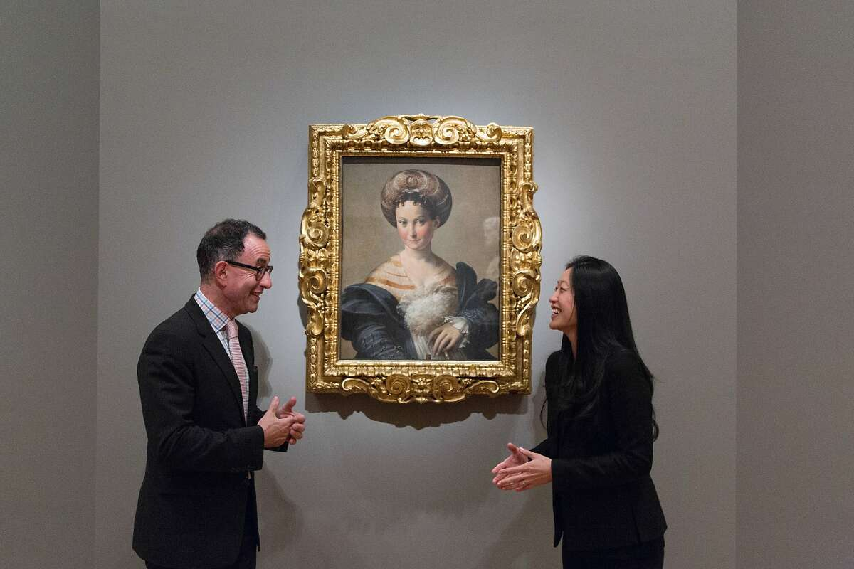 Fine Arts Museums director Colin Bailey with Aimee Ng, a curator from the Frick in New York who has written a small catalog for the show, in front of a celebrated painting by Parmagianino at the Legion of Honor in San Francisco, Calif., Friday July 26, 2014
