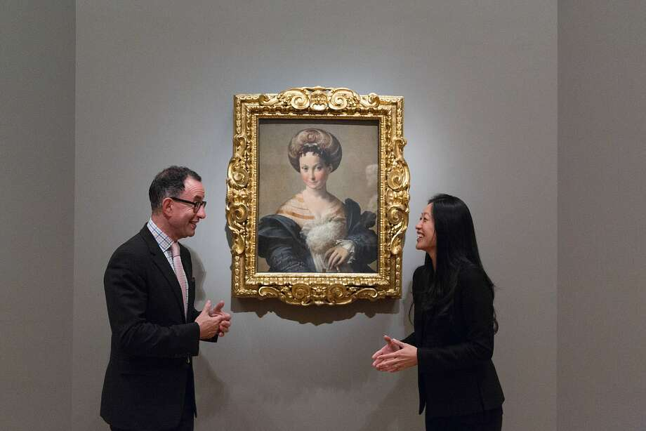 "Fine Arts Museum director Colin Bailey and Aimee Ng, a curator from the Frick in New York, in front of ""Schiava Turca."" Photo: Jason Henry, Special To The Chronicle"